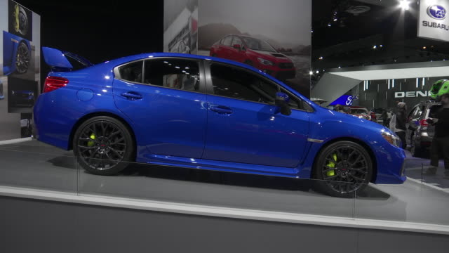 """subaru hanging sign / wrx"""" white letters on purple carpet; tilt up - front end of red wrx / front quarter driver side view of wrx / rear license... - subaru stock videos & royalty-free footage"""