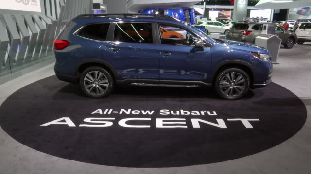 subaru passenger side profile / sign on carpet; tilt up - passenger side profile / closeup subaru logo; zoom out - front end / promotional video on... - subaru stock videos & royalty-free footage