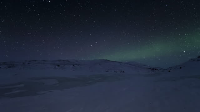 t/l of subdued aurora on frozen lake - arctic stock videos & royalty-free footage