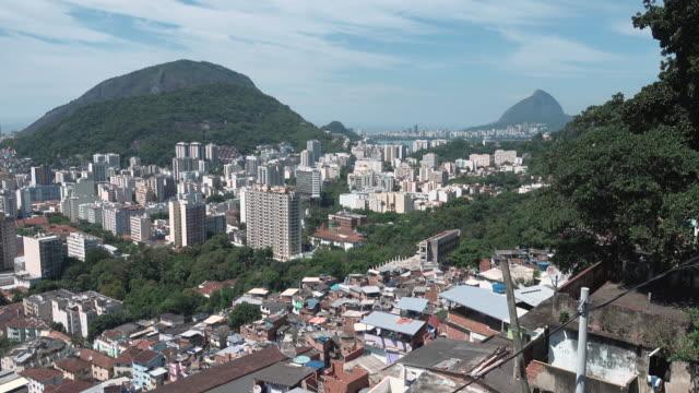 subjective view of santa marta's hill / slum at rio de janeiro - スラム街点の映像素材/bロール