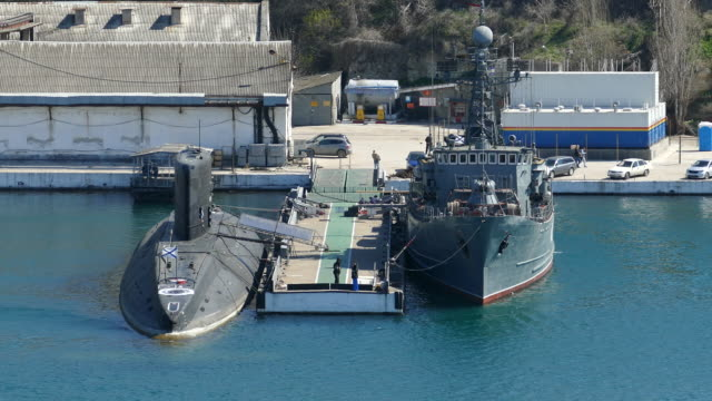 submarine and minesweeper at the pier - minesweeper stock videos and b-roll footage