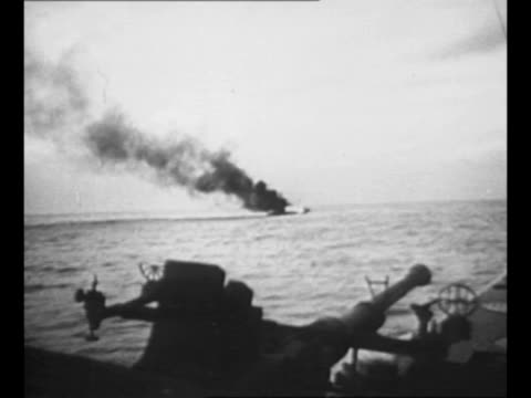 vídeos y material grabado en eventos de stock de submarine crew members run to their stations at the sub's guns / tracer bullets from sub hit japanese warning ship / ws japanese ship burns / two... - munición