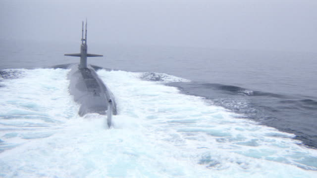 a submarine cruises on the ocean's surface. - 1989 stock videos & royalty-free footage