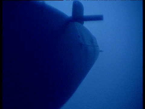 Submarine cruises toward and past camera