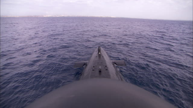 A submarine floats at the surface of the ocean.