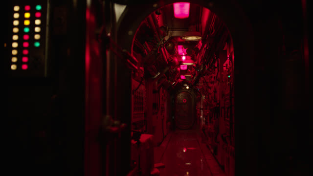 int. submarine hallway/corridor; red lights flashing, water leaks from ceiling and side - submarine stock videos & royalty-free footage