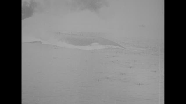 submarine submerges / wake from torpedo moves in water / ship and smoke after hit / ship rolls over in water, with people running on ext hull and... - torpedo stock videos & royalty-free footage