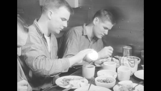 submarine uss haddock docked at harbor / sailors sitting at table eating inside dining room of the submarine / vs sailors sitting at table eating /... - wohngebäude innenansicht stock-videos und b-roll-filmmaterial