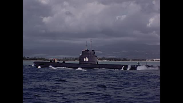 1960 Submarine USS Wahoo (SS-565) / Tourists on sailboat off coast of Oahu, Diamond Head visable