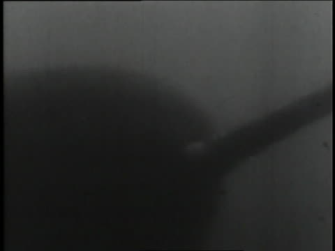 stockvideo's en b-roll-footage met a submariner uses sophisticated equipment to launch a missile while submerged. - raket wapen