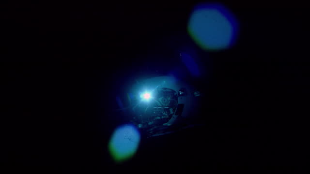 submersible lights as it rises from deep ocean floor, mid atlantic ridge - submarine stock videos and b-roll footage