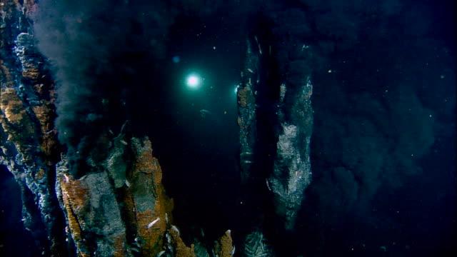 Submersible lights illuminate black smoker deep sea vent on ocean floor, Mid Atlantic Ridge