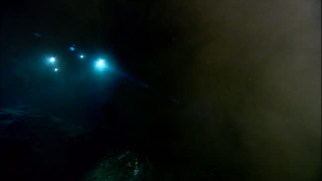 submersible lights illuminate black smoker deep sea vent on ocean floor, mid atlantic ridge - seabed stock videos & royalty-free footage
