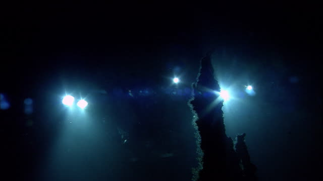 submersible lights illuminate black smoker deep sea vent on ocean floor, mid atlantic ridge - exploration stock videos & royalty-free footage