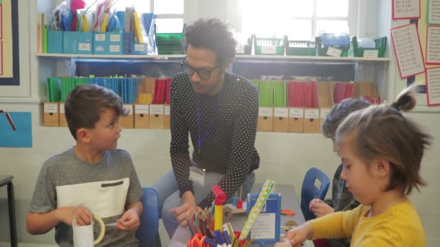 a substitute tutor helping in a lesson - art and craft stock videos & royalty-free footage