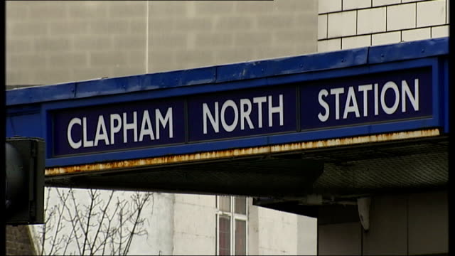 london clapham ext close up shot clapham north tube station long shot clapham north tube station with traffic in foreground tilt down road kerb floor... - kerb stock videos and b-roll footage