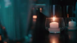 Subtle Flickering Candle in a Nightclub.