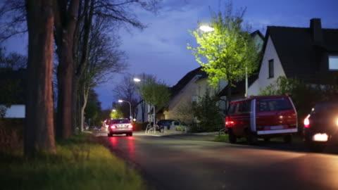 crane up: suburb at night - street light stock videos & royalty-free footage