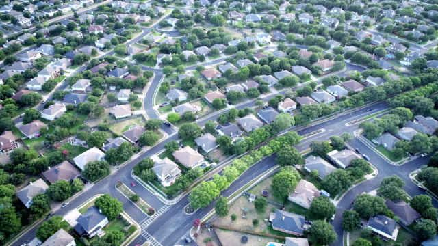 suburb living drone angle looking down above thousands of homes austin , texas suburbia - real estate stock videos & royalty-free footage