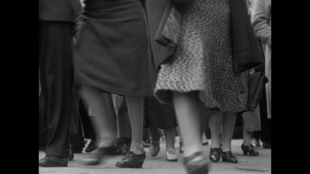 montage suburban british civilians arrive in the city to work after a long commute on the train / london, england, united kingdom - 1939 stock-videos und b-roll-filmmaterial