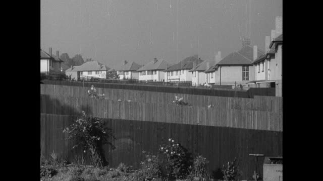 stockvideo's en b-roll-footage met montage suburban british life with large homes, fresh air, light and kids can playing safely / london, england, united kingdom - 1930 1939