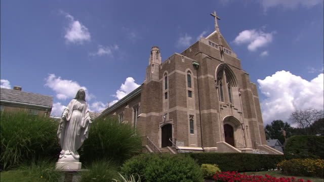 suburban church with statue of the virgin mary - catholicism stock videos and b-roll footage