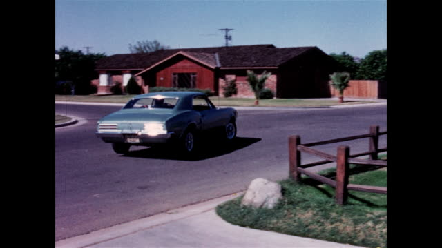 suburban family drives 1967 pontiac firebird - 1967 stock videos & royalty-free footage