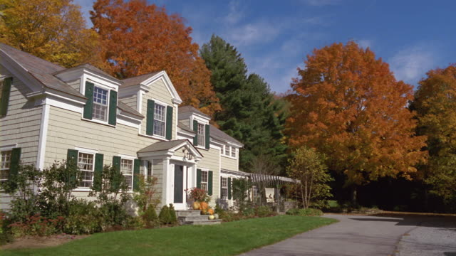 ms suburban home and trees in fall foliage / manchester, vermont - autumn stock videos & royalty-free footage
