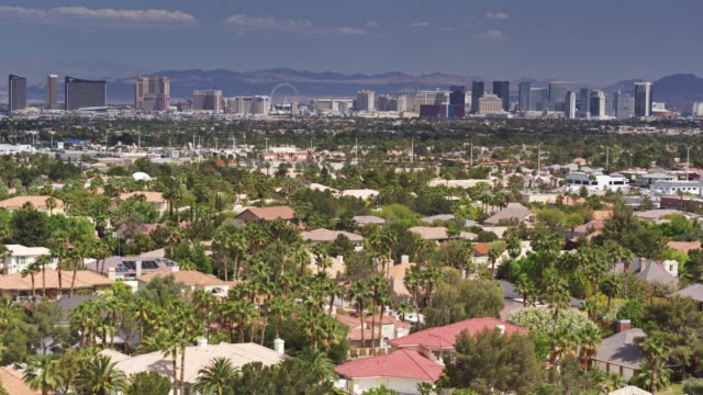 suburban homes in las vegas with view of the las vegas strip - drone shot - las vegas stock videos & royalty-free footage