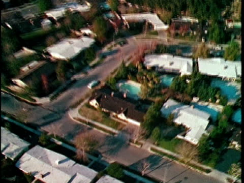 1970 AERIAL MONTAGE Suburban homes, Los Angeles, California, USA, AUDIO