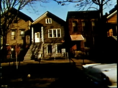 1963 MONTAGE POV DISSOLVE Suburban houses from moving car / Chicago, United States / AUDIO