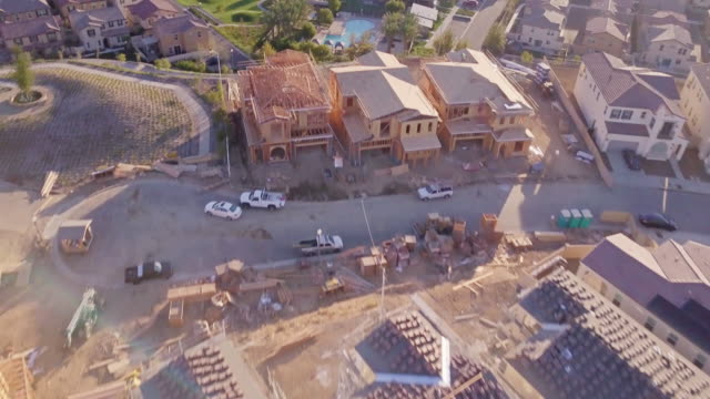 suburban housing development at golden hour - aerial view - tract housing stock videos & royalty-free footage