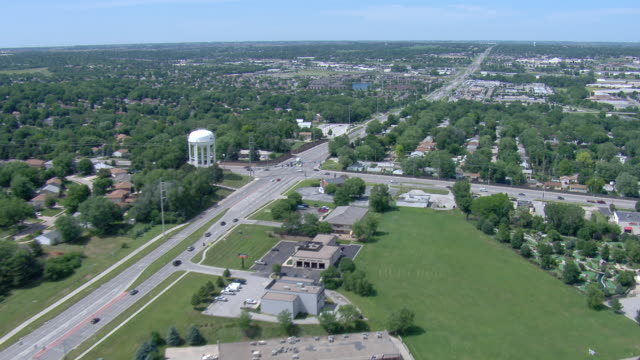 Suburban intersection with light traffic and water tower