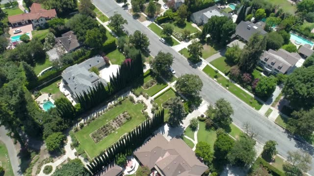 suburban neighborhood aerial flyover - driveway stock videos & royalty-free footage