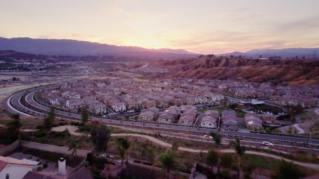suburban neighborhood at dusk - aerial view - santa clarita video stock e b–roll