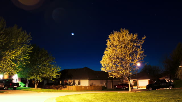suburban neighborhood timelapse of moon setting - suburban stock videos and b-roll footage