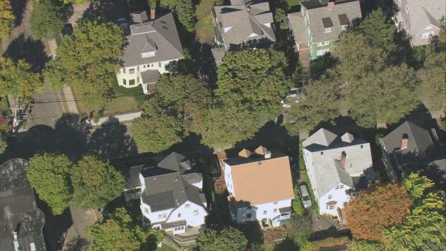 aerial suburban rooftops with some autumn foliage / boston, massachusetts, united states - boston massachusetts stock videos & royalty-free footage