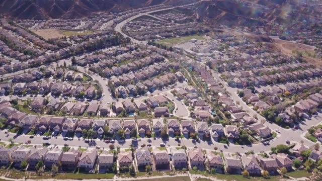 suburban sprawl in california - aerial view - tract housing stock videos & royalty-free footage