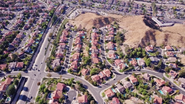 suburban sprawl in southern california - aerial view - housing difficulties stock videos & royalty-free footage