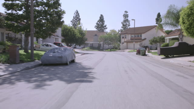 pov suburban street from cul-de-sac - tracking shot stock videos & royalty-free footage