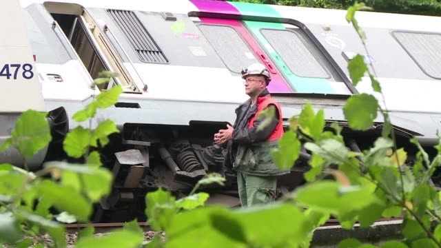 A suburban train overturned outside Paris on Tuesday after days of downpours caused an embankment to collapse slightly injuring seven people...
