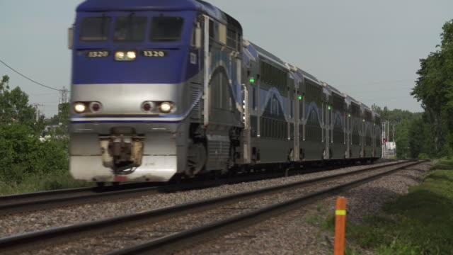 Suburban train passing on railway