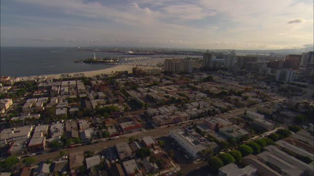 AERIAL Suburbs and beach with marina, port in distance, Long Beach, California, USA