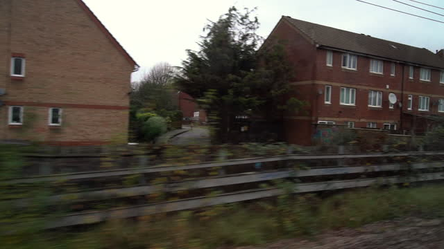 suburbs of london in slow motion from train window - cinematography stock videos & royalty-free footage