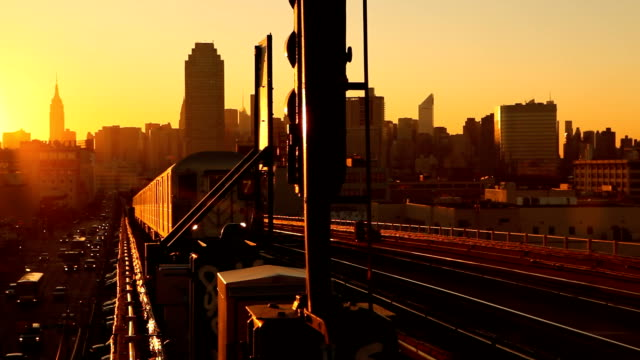subway 7 train at sunset in queens new york city - underground train stock videos & royalty-free footage