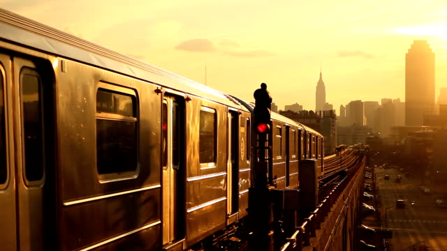 subway 7 train at sunset in queens new york city - high up stock videos & royalty-free footage