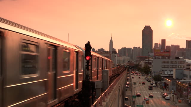 subway 7 train at sunset in sunnyside queens - queens new york city stock videos & royalty-free footage