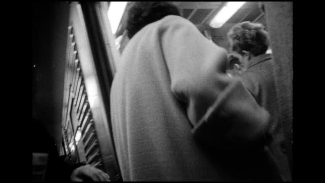 vídeos de stock e filmes b-roll de 1966 nyc subway commuters - jornal