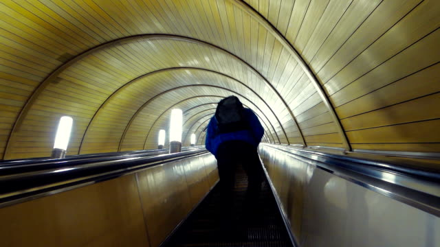 subway escalator with people going upstairs - elevated walkway stock videos & royalty-free footage