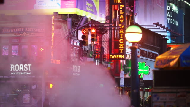 nyc subway globes light and many colorful neon signs glow among the rising steam in the night around the times square in midtown manhattan new york city ny usa on jan. 14 2020. - theatre district stock videos & royalty-free footage